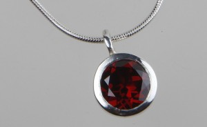 Husk with Faceted Garnet